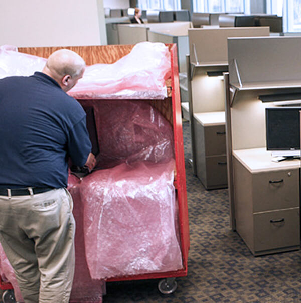 A professional mover moving office workstations
