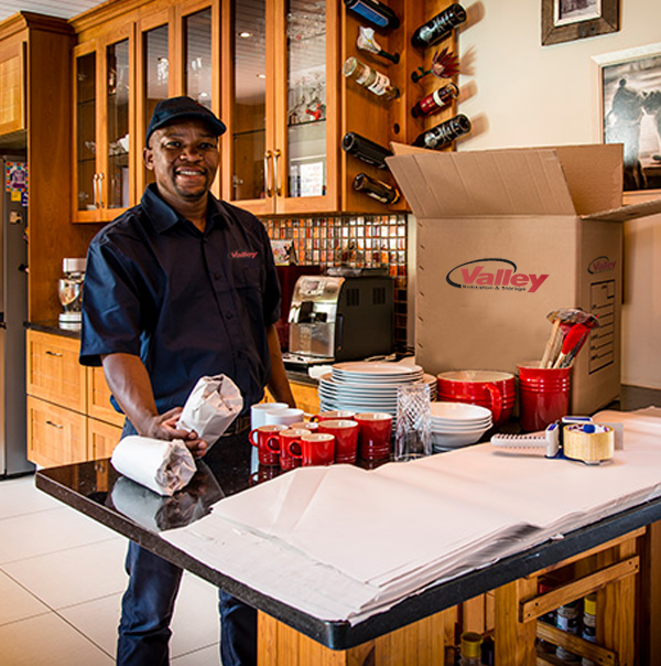 Valley Relocation San Jose Moving Company packer working in kitchen